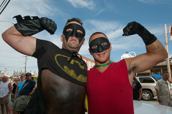 DESI SMITH/Staff photo. Dynamic Duel, (Batman) Shane Wilson and (Robin) Mark Horgan out front of the St.Peter's Club, before heading out to walk the Greasy Pole Saturday afternoon during the St Peter's Fiesta.<br />  June 28,2014