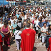 MARIA UMINSKI/GLOUCESTER DAILY TIMES Parishioners line up to recieve communion during the Outdoor Mass for St. Peter's Fiesta on June 29, 2014.