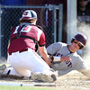 Gloucester senior captain Jordan Pallazola (10) reaches over and applies the tag to sliding Belmont freshman Cal Christofori, on a failed squeeze play at the plate in the fourth inning of play at Nate Ross Field in Gloucester on Saturday afternoon. The top seeded Fishermen managed to stay alive in the D2 North Tournament with a 3-2 walk off win over ninth seeded Belmont in the bottom of the 7th inning as pinch hitter Tyler Favaloro singled home Lukas McRobb with the winning run. DAVID LE/Staff photo. 5/31/14