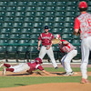 DESI SMITH/Staff photo.    Gloucester's Curtis Quinn dives back to first in the MIAA North Sectional Championship game against Masconomet held Saturday afternoon at LeLacheur Park in Lowell    June 7,2014