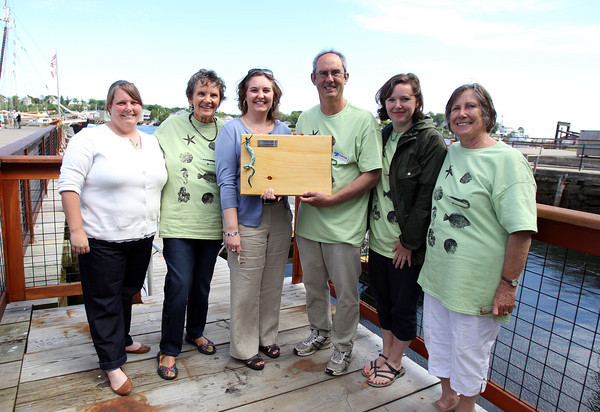 From left, Mary Kay Taylor, Education Director of Maritime Gloucester, Dr. Clarice Yentsch, Emily Chandler, receiving the Sarah Fraser Robbins Environmental Award on behalf of Molly Lutcavage, Tom Balf, Executive Director of Maritime Gloucester, Kirsten Brewer, and Sarah Robbins Evans, at the Celebration of the New Edition of The Sea Is All About Us and the Sarah Fraser Robbins Environmental Award, on Saturday afternoon. DAVID LE/Staff photo. 6/21/14.