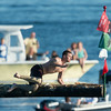 DESI SMITH/Staff photo.  Jack Russ stays focused as he's about to take down the flag, in Friday's Greasy Pole contest off Pavilion Beach.<br />   June 27,2014