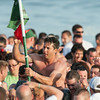 DESI SMITH/Staff photo.    Mark Allen is carried to shore after taking down the flag at Sundays Greasy Pole Contest.<br />   June 28,2014