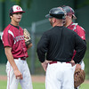 DESI SMITH/Staff photo.    Gloucester's pitcher Connor Harris,is surprised when head coach Bryan Lafata puts him in the outfield in the bottom of the seventh with two outs against North Andover in the D2 North Semifinals Friday afternoon at Frazer Field in Lynn. He was replaced by Peter Clark, who rercorded the save for Gloucester, who will move on in the finals.   June 6,2014