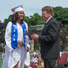 DESI SMITH/Staff photo.   Principal Erik Anderson presents Stephanie Agosto-Baez with her deploma,Sunday afternoon at Gloucester High School Graduation ceremoies, at New Balance Track and Field at Newell Stadium.  June 8,2014