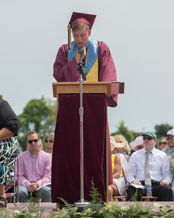 DESI SMITH/Staff photo.   Class President, Kevin Rogers speaks at Sunday afternoon's Gloucester High School Graduation ceremoies, at New Balance Track and Field at Newell Stadium.  June 8,2014