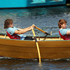Canadiens John Ernst, left, and Thomas Stuart, right, paddle at the start of the Junior's Division dory race on Saturday morning. DAVID LE/Staff photo. 6/21/14.