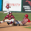 DESI SMITH/Staff photo.    Gloucester's Curtis Quinn tags out Masconomet's Elias Varinos during the MIAA North Sectional Championship game against  held Saturday afternoon at LeLacheur Park in Lowell    June 7,2014