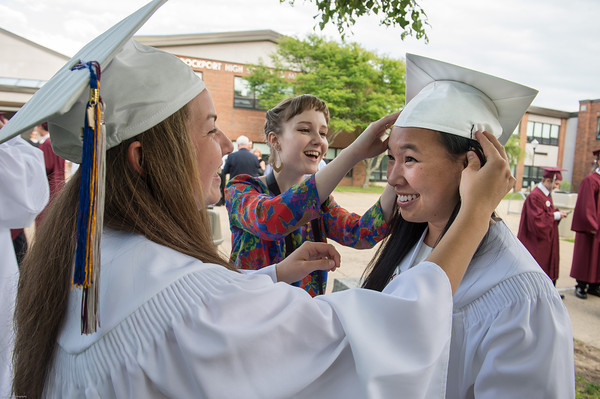 DESI SMITH/Staff photo.  Abby Hood (left) and Becky Endicott, help Kim McEachern with her cap,before heading inside for graduation, Friday night at Rockport High School.    June 6,2014