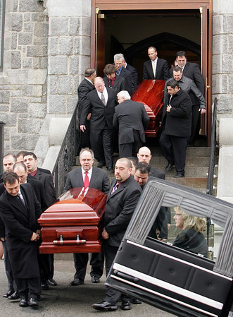 Gloucester: The caskets of John Orlando and Matteo Russo are brought out of St. Ann Church after the funeral service held for the two fishermen Thursday morning. Mary Muckenhoupt/Gloucester Daily Times