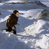 Manchester: Ryan Meehan, 6, tries to hide behind a large snowbank outside Manchester Memorial School yesterday as he has a snowball fight with his dad. Meehan attends kindergarten at the school. Photo by Kate Glass/Gloucester Daily Times Tuesday, January 6, 2008