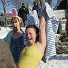 Gloucester:  Nancy Bishop, right, and Sharon Bragg celebrate after their icy swim at Oak Cove Beach on Rocky Neck for the anuula Rocky Neck Plunge Thursday morning.  Mary Muckenhoupt/Gloucester Daily Times