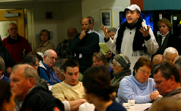 Gloucester: Carl McKay, whose parents live directly behind 76 Eastern Ave., asks about the difference in response to a minor gas leak and major gas leak during a meeting at the Rose Baker Senior Center Thursday night. The room was full of residents concerned about gas leaks in the city following Sunday's explosion. Photo by Kate Glass/Gloucester Daily Times Thursday, January 29, 2009