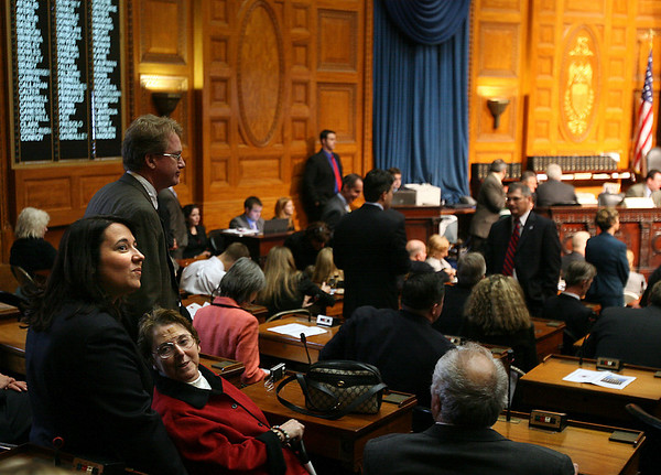 Boston: State Rep. Ann-Margaret Ferrante looks up to friends and supporters from the House Floor during her first day in office at the State House yesterday. Ferrante's mother, Frances, got to sit in her seat for the oath of office ceremony. Photo by Kate Glass/Gloucester Daily Times Wednesday, January 7, 2009