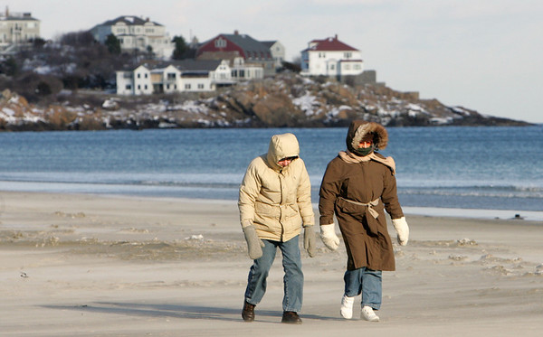 "Gloucester:  Arthur and Jean Danikas of Rockport walk Good Harbor Beach despite the raw temperature and blowing wind Saturday.  The Danikas, who have been married 56 years, walk the beach everyday saying they call Good Harbor Beach ""our place."" Mary Muckenhoupt/Gloucester Daily Times"