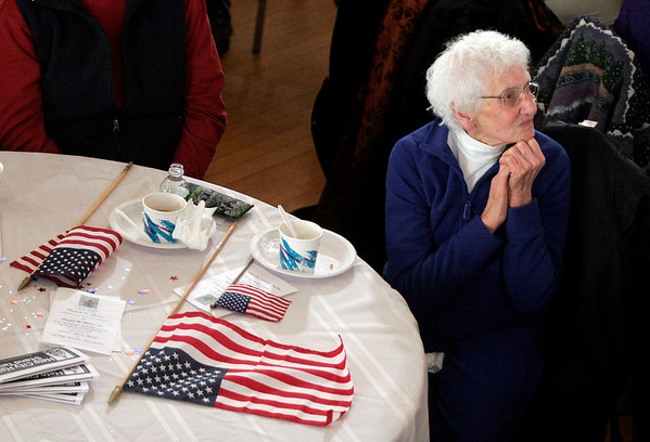 Gloucester: Pearl Goodwin clasps her hands together as she watches President Barak Obama deliver his inaugural address from Gloucester City Hall yesterday afternoon. Photo by Kate Glass/Gloucester Daily Times Tuesday, January 20, 2009