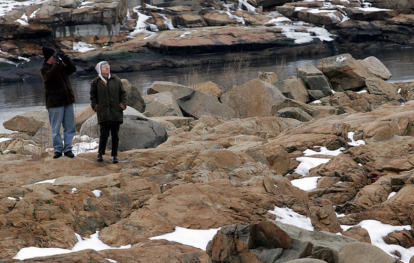 Rockport: Scott and Liz Wood, owners of The Tuck Inn, search for the snowy owl at Loblolly Cove on Monday afternoon. The two take advantage of the usually quiet winter season to go birding. Photo by Kate Glass/Gloucester Daily Times Tuesday, January 6, 2008