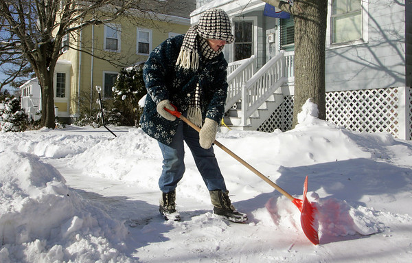 Manchester: Judy delRosario shovels the sidewalk in front of her house on Forest Street Thursday morning. This was delRosario's second time out to shovel after already clearing the sidewalk and driveway the night before.  Mary Muckenhoupt/Gloucester Daily Times