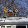 Gloucester: Gloucester firefighters Captain Tom LoGrande, John Nicastro, and Buddy Doucette work to extinguish a chimney fire on Thurston Point Road yesterday afternoon. Photo by Kate Glass/Gloucester Daily Times