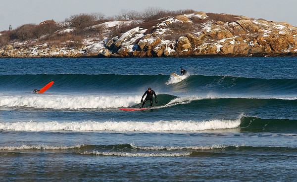 Gloucester: Surfers take advantage of the warmer weather and clean waves at Good Harbor Beach on Thursday. Photo by Kate Glass/Gloucester Daily Times Thursday, January 29, 2009