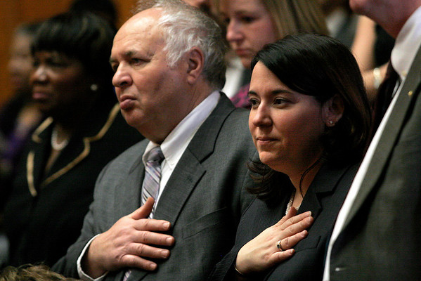 Boston: State Rep. Ann-Margaret Ferrante and her father, Joseph Ferrante, stand for the Pledge of Allegiance during her first day in office at the State House yesterday. Photo by Kate Glass/Gloucester Daily Times Wednesday, January 7, 2009