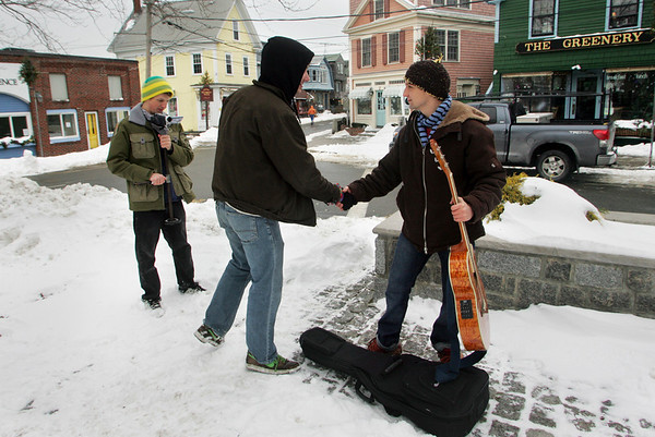 """Rockport:  Mike Kelly, left, films Tom Rash and Jarid Pasek, right, as they act out a scene from a movie written and directed by Kelly called """"A Boy Named Torry and a Little Harmony"""" in Dock Square Friday afternoon.  Kelly and his cast of friends have been filming the movie, which is about music and connections, recently at various Rockport locations. Mary Muckenhoupt/Gloucester Daily Times"""