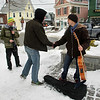 "Rockport:  Mike Kelly, left, films Tom Rash and Jarid Pasek, right, as they act out a scene from a movie written and directed by Kelly called ""A Boy Named Torry and a Little Harmony"" in Dock Square Friday afternoon.  Kelly and his cast of friends have been filming the movie, which is about music and connections, recently at various Rockport locations. Mary Muckenhoupt/Gloucester Daily Times"