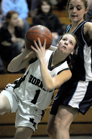 Manchester:M/E Lizzy Ball eyes the basket as she shoots of ballance against Wilmington last night at M/E High School.<br /> Photo by Desi Smith/Gloucester Daily Times Friday, January 23, 2009