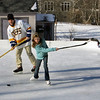 Essex: Brent Roundy and his daughter Abbey, 9, play hockey in the ice rink they have in their yard on Martin Street Saturday afternoon.  Brent made the rink himself and admits that it was a lot of work but loves having the neighborhood kids come and use it. Mary Muckenhoupt/Gloucester Daily Times