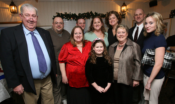 Melissa Gliddem, far right, who received the Sarah Lufkin Memorial Scholarship, stands with members of the Lufkin family during an event to benefit the scholarship fund at Periwinkles in Essex Tuesday night. Members of the family are: (back row L-R) Don Williams, Jason Gilbert, Kate Lufkin, Laurie Lufkin, Tim Burton, (front row L-R) George Lufkin, Kim Williams, Lily Phipps, and Sue Lufkin. Sarah Lufkin was studying to be a special education teacher before falling to leukemia in 1997. The scholarship is awarded to a student who is pursuing a career that will affect the lives of children. Photo by Kate Glass/Gloucester Daily Times Tuesday, January 13, 2009
