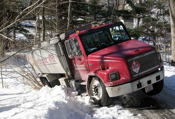 Manchester: A Hawthorne Oil truck slid down a steep, icy driveway while making a delivery to a School Street home Thursday afternoon.  Mary Muckenhoupt/Gloucester Daily Times