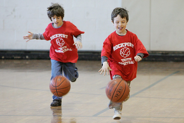 Rockport: Alexander Strzemilowski, 7, left, and Luke Simpson, 8, dribble down the court while playing red light green light during youth basketball at Rockport High School Saturday afternoon. Green light you ran and dribbled and red light you had to stand still.  Mary Muckenhoupt/Gloucester Daily Times