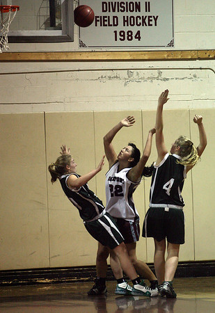 Rockport: Rockport's Tia Nelson looks for the rebound as Manchester Essex's Abbi Biggar gets knocked to the floor and teammate Julia Martz applies pressure. Photo by Kate Glass/Gloucester Daily Times Monday, January 5, 2008