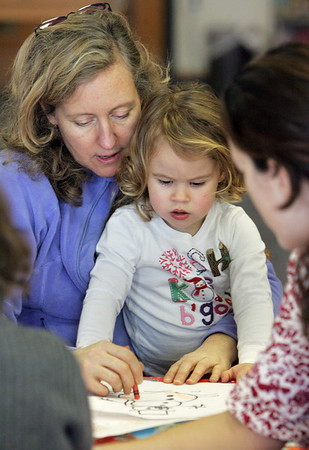 """Gloucester:  Lisa Smith and her daughter April, 2, color together in the children's room of the Sawyer Free library Saturday afternoon.  """"It's library season,"""" says Smith who came to the library with April for something fun to do on a cold day. Mary Muckenhoupt/Gloucester Daily Times"""