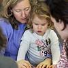 "Gloucester:  Lisa Smith and her daughter April, 2, color together in the children's room of the Sawyer Free library Saturday afternoon.  ""It's library season,"" says Smith who came to the library with April for something fun to do on a cold day. Mary Muckenhoupt/Gloucester Daily Times"