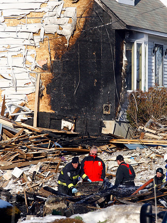 Gloucester: Crews from National Grid and the State Fire Marshall's Office investigate the scene of a home explosion at 76 Eastern Ave. in Gloucester. The explosion, which happened early Sunday morning, critically injured Gloucester Police Officer Wayne Sargent. Photo by Kate Glass/Gloucester Daily Times Monday, January 26, 2009