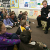 "Essex: Essex Police Officer Jim Romeos reads ""Officer Buckle and Gloria"" to Judy Carbrey's kindergarten class at Essex Elementary School yesterday morning. The school invited nine guest readers from the community to share stories with the children. Photo by Kate Glass/Gloucester Daily Times Tuesday, January 27, 2009"