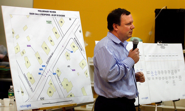 Gloucester: John Higgins, a spokesman for National Grid, stands near a chart detailing gas-related incidents in the area of 76 Eastern Ave., which was the site of a home explosion on Sunday, during a meeting with residents at the Rose Baker Senior Center on Thursday. Photo by Kate Glass/Gloucester Daily Times Thursday, January 29, 2009