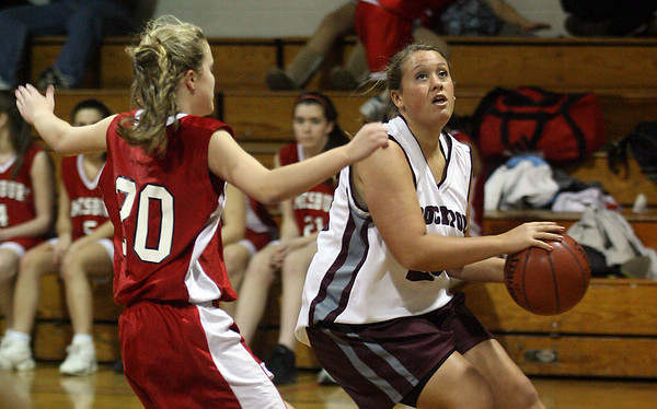 Rockport: Rockport's Morgan Weir tries to shoot as Amesbury's Colleen Brockmyer defends the hoop during their game at Rockport last night. Photo by Kate Glass/Gloucester Daily Times Monday, January 12, 2009