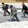 Rockport: From left, Declan Beaton, 9, his brother Hayden, 8, and their friend Will Andrews stay warm by playing hockey at Henry's Pond Saturday afternon.  Mary Muckenhoupt/Gloucester Daily Times