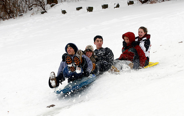 Rockport: From left: Derick MacDowell, Dylan McDonough, Rob Nelson, Emma Littlefield, and Allie McManus form a chain as they sled at Evans Field in Rockport yesterday afternoon. Photo by Kate Glass/Gloucester Daily Times Wednesday, January 28, 2009