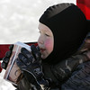 Rockport: Griffin Beaton, 5, of Rockport stays warm with some hot chocolate while he watches his brothers play hockey on Henry's Pond Saturday afternoon. Once Griffin ran out of hot chocolate he suited up and headed back onto the ice. Mary Muckenhoupt/Gloucester Daily Times