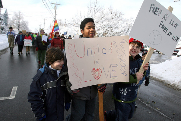 """Rockport: Thomas Micalizzi, left, Alex James, a.k.a. """"A.J.,"""" and Gaetano Micalizzi, right, lead the 21st Annual MLK March through downtown Rockport yesterday morning. Around 50 people joined the march, which is organized by the Unitarian Universalist Society of Rockport. Photo by Kate Glass/Gloucester Daily Times Monday, January 19, 2009"""