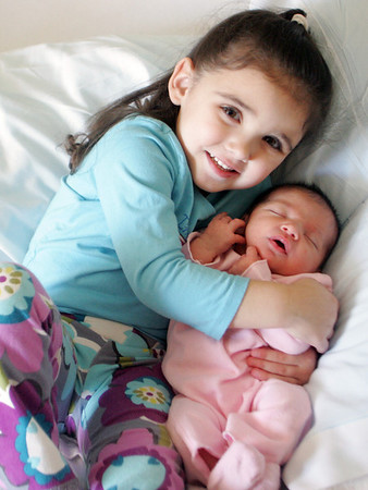 Gloucester: Lily Sutera, born on January 1st, seen with her older sister Katie,3, was the fist baby born in Beverly Hospital and Cape Ann's first arrival of 2009.  Mary Muckenhoupt/Gloucester Daily Times