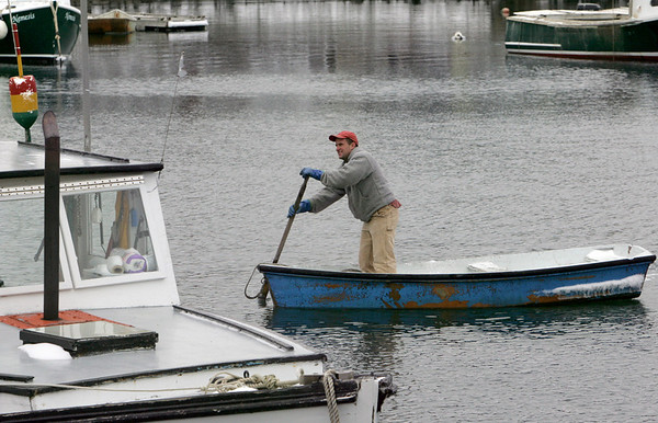 Rockport: Bob Beloff rows in from his boat New Horizons in Rockport Harbor after what Beloff said was a cold day of lobstering Friday afternoon. Mary Muckenhoupt/Gloucester Daily Times