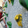 Manchester: J.P. Rouillard, a third grader at Manchester Memorial Elementary School, climbs the rock climbing wall during gym class Friday morning.  Chris Lamothe, a gym teacher at the school, says that the rock climbing wall works on upper body streght, requires kids to think ahead and stategize their route, as well boost their confidence. Mary Muckenhoupt/Gloucester Daily Times