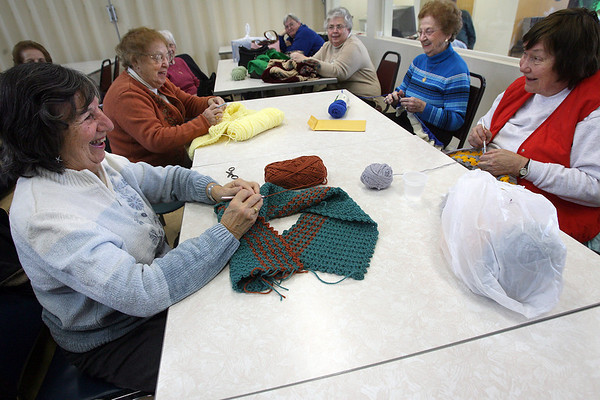 Gloucester: From left: Pauline Dion, Carmella Scola, Mary Agnes Randazza, Caroline Marchant, and Ida Bammarito knit items to donate to veterans, nursing homes, and Pathways for Children. The group meets every Tuesday at the Rose Baker Senior Center from 10-12. Photo by Kate Glass/Gloucester Daily Times Tuesday, January 13, 2009