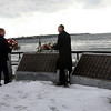 Gloucester: Employees of Greely Funeral Service throw wreaths of flowers into the ocean at the Fishermen's Memorial during the funeral procession for Gloucester fishermen Matteo Russo and John Orlando yesterday. Photo by Kate Glass/Gloucester Daily Times Thursday, January 8, 2009