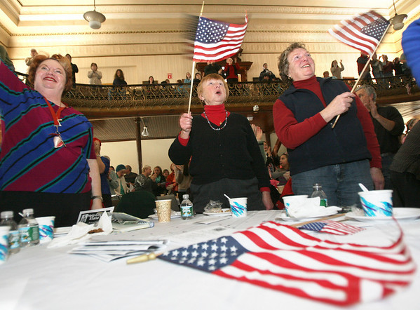 Gloucester: Nancy Williams, Nancy McKay, and Carol Sampson, cheer as they watch President Barak Obama's inauguration from Gloucester City Hall yesterday afternoon. A couple hundred people gathered to watch the historic event. Photo by Kate Glass/Gloucester Daily Times Tuesday, January 20, 2009
