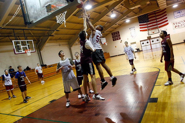 Rockport: C.J. Dowdell leaps over his teammates as the Rockport boys basketball team works on drills during practice last night. The team has already won more games this season than last. Photo by Kate Glass/Gloucester Daily Times Thursday, January 22, 2009